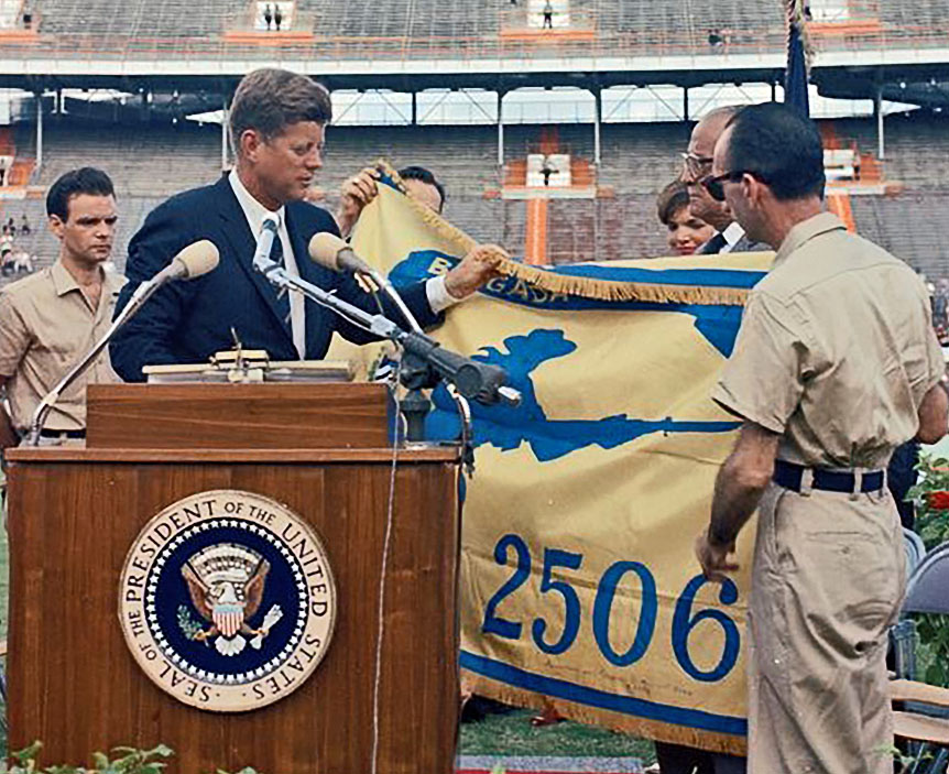 President Kennedy receives the flag of the 2506 Brigade
