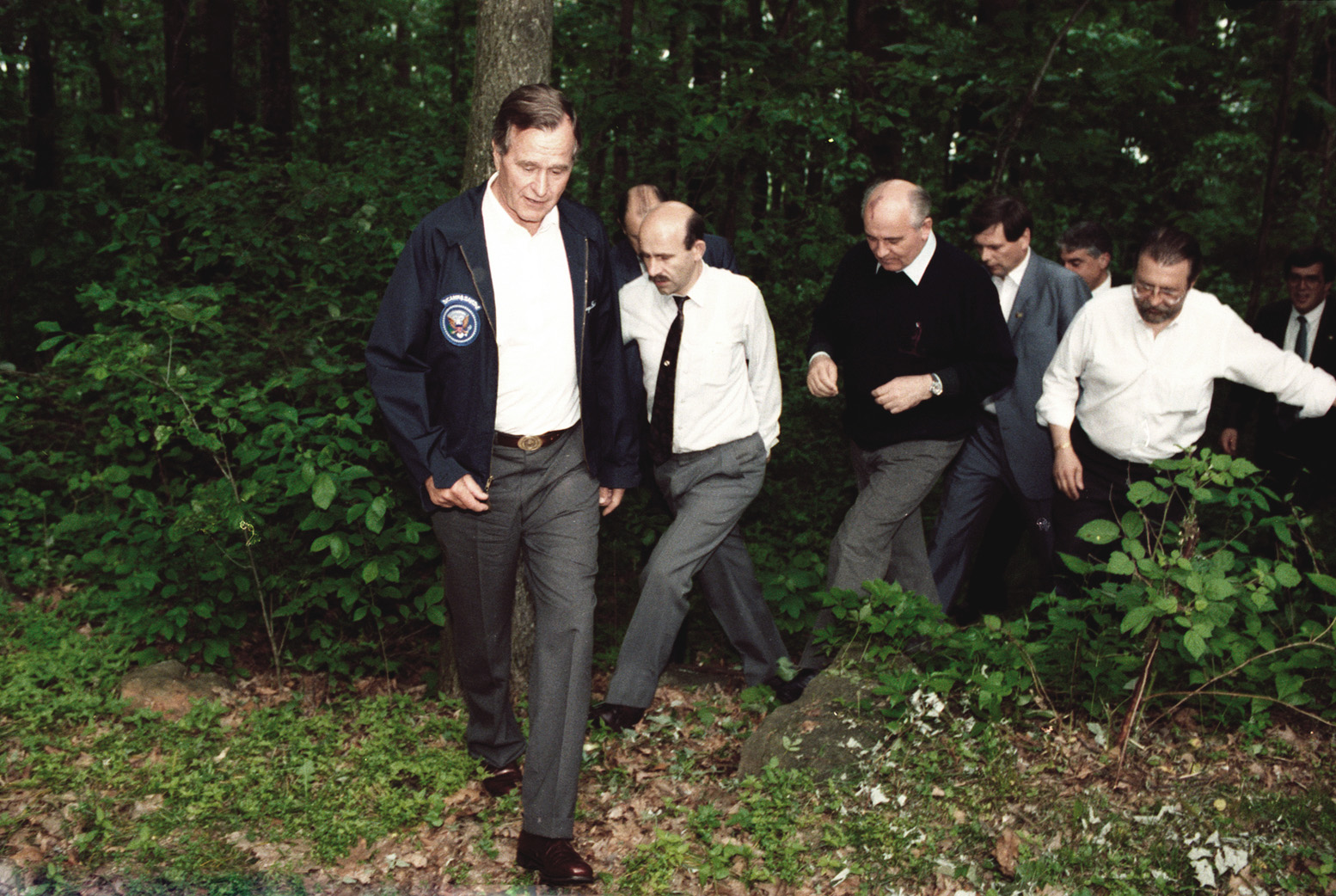 Bush, Gorbachev and а coterie of security agents in camp David woods