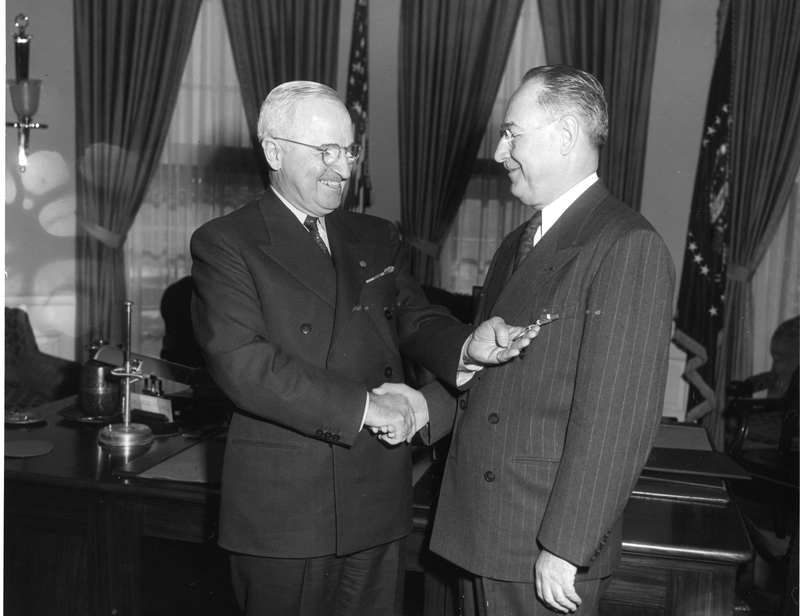 President Harry S. Truman (left) presents the Distinguished Service Medal to Rear Admiral Sidney Souers, U.S. Naval Reserve (right), 1 December 1952.