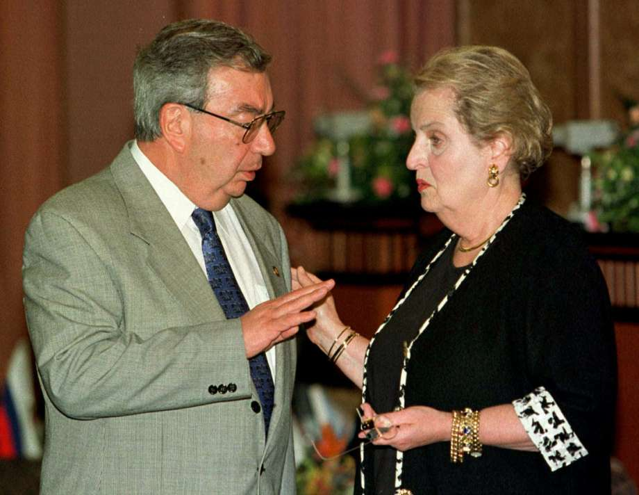The captions should just say, U.S. Secretary of State Madeleine Albright with Evgeny Primakov.