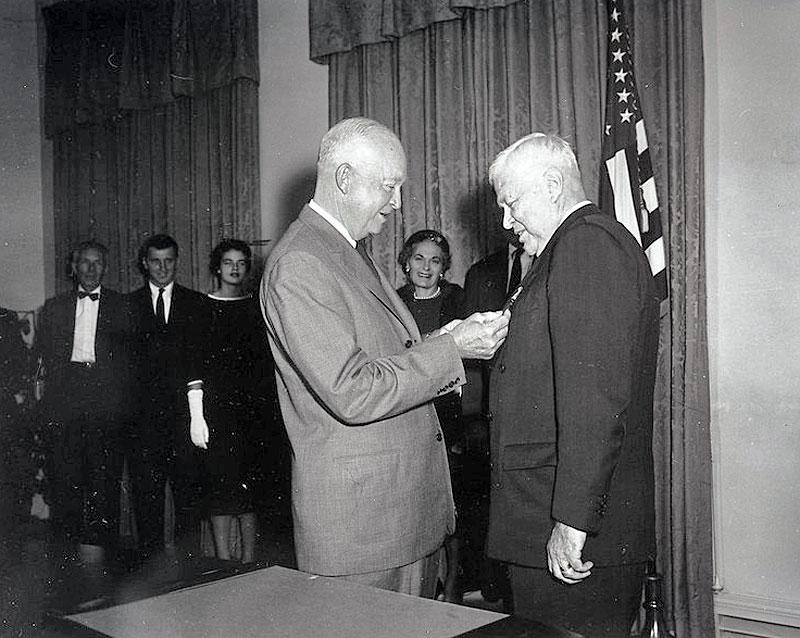Secretary of Defense Charles Wilson receiving a medal from President Eisenhower