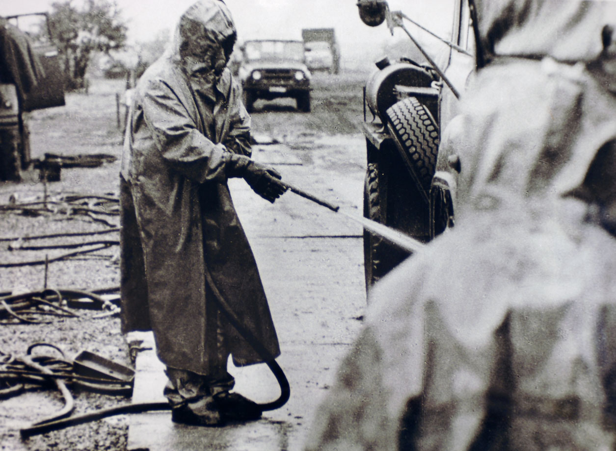A liquidator decontaminating a truck