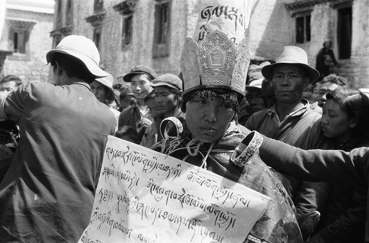 An officer in the People's                                   Liberation Army in Lhasa when the                                   Cultural Revolution broke out in 1966,                                   a Buddhist nun is forced to wear a                                   sign labeling her as a                                   counterrevolutionary