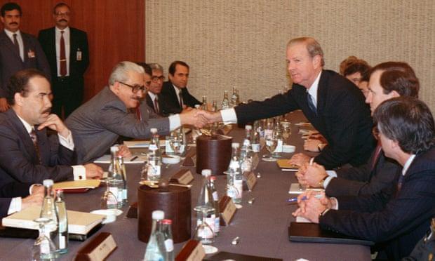 Baker shakes hands with Tariq Aziz