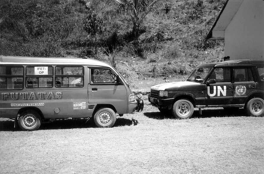 IFET-OP and UN vehicles at polling place, Aug. 30, 1999