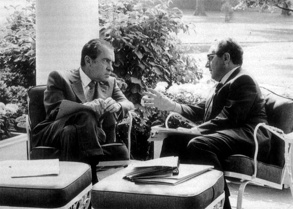 Nixon and Kissinger on a porch