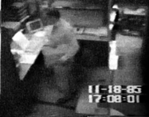 Surveillance video frame purporting to show Pollard stealing classified documents