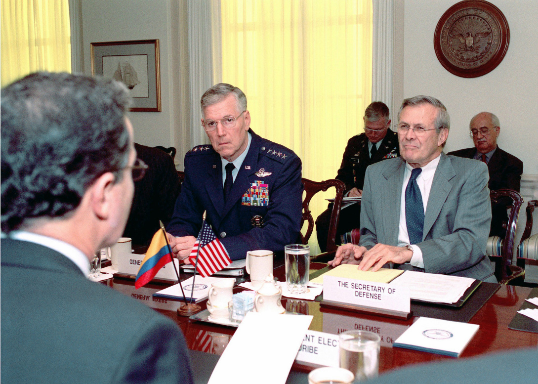 Defense Donald H. Rumsfeld (right) and Air Force Gen. Richard B. Myers (left)